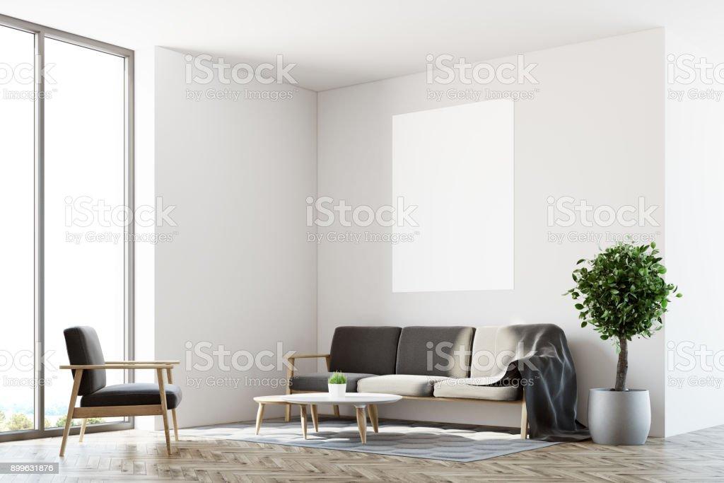 White living room, sofa, poster side stock photo
