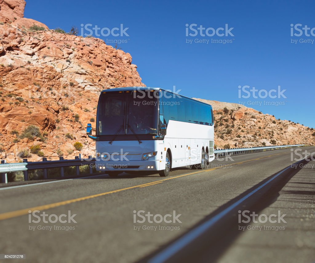 White long-distance bus driving through National Park USA