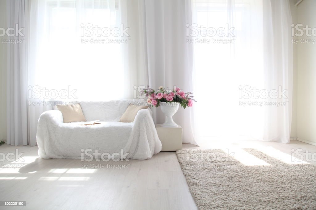 White lounge sofa large Windows and color book stock photo