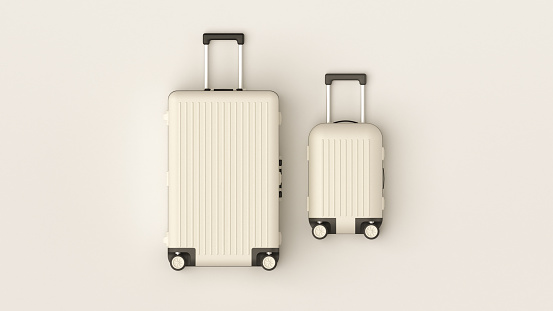 Travel minimalist concept, black and white classic baggage mockup, small and big. Suitcase accessory set, journey concept. White luggage set on white background, top view image, flat lay composition.