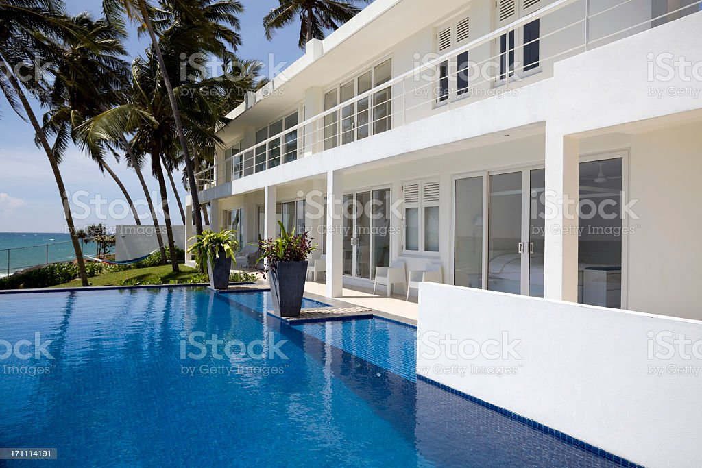 White luxurious villa in Sri Lanka with palm trees and pool royalty-free stock photo
