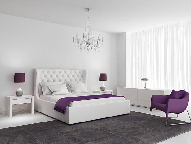 White luxury bedroom with purple armchair stock photo