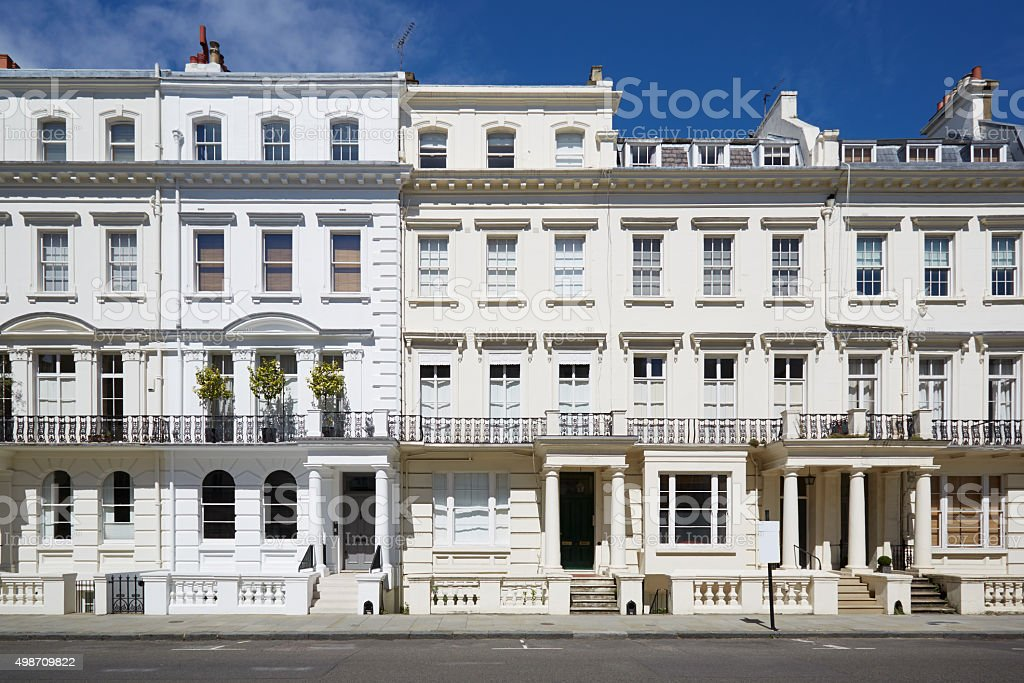 White luxury houses facades in London White luxury houses facades in London, Kensington and Chelsea architecture in a sunny day with blue sky 2015 Stock Photo