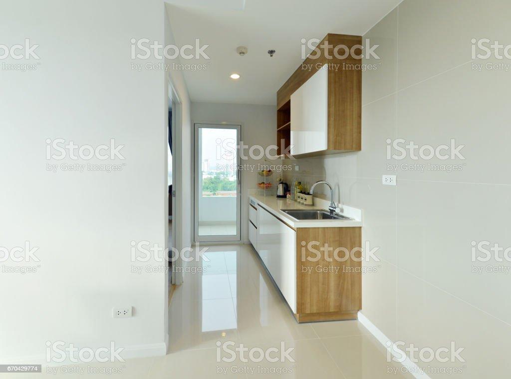 White Luxury Modern Kitchen And Decoration In Apartment Interior