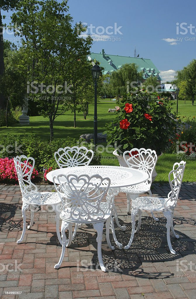 White luxury table and chairs in hotel garden royalty-free stock photo