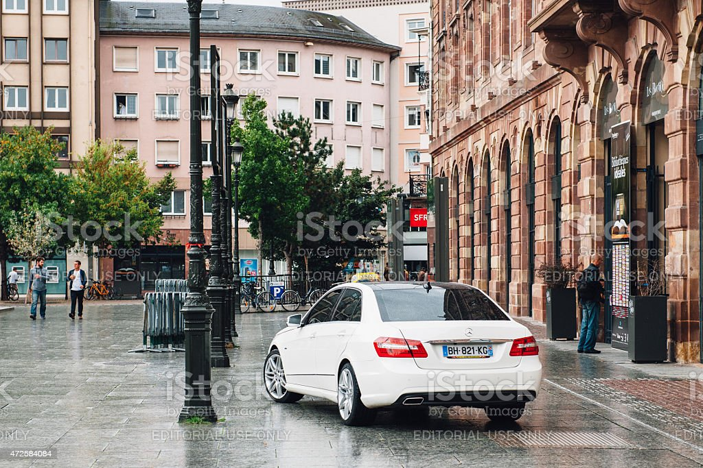 White luxury taxi car limousine waiting for client stock photo
