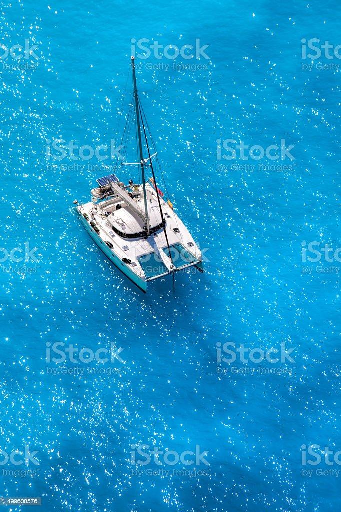 White luxury yacht against azure sea stock photo