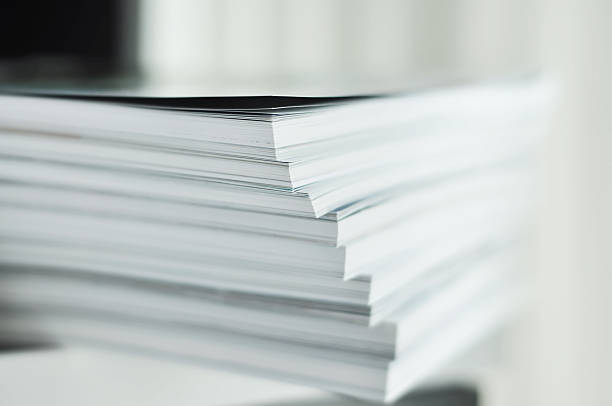 white magazine stacks close up - publication stock pictures, royalty-free photos & images