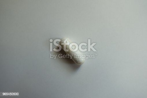 1 White Magnesium Citrate Supplement Capsule From Above Stock Photo & More Pictures of Assistance