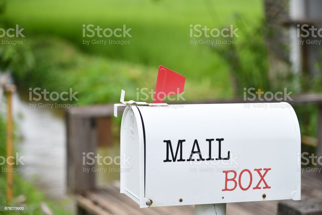 White Mail Box in Front of a House stock photo