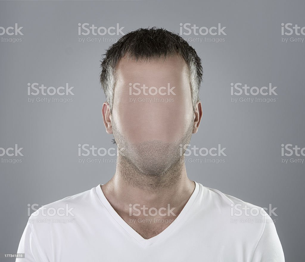 A white male in white tee shirt with wiped out face stock photo