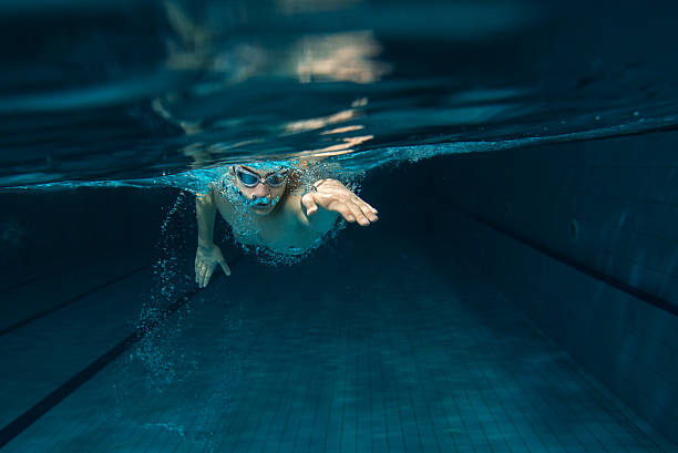 A white male swimmer in the pool stock photo