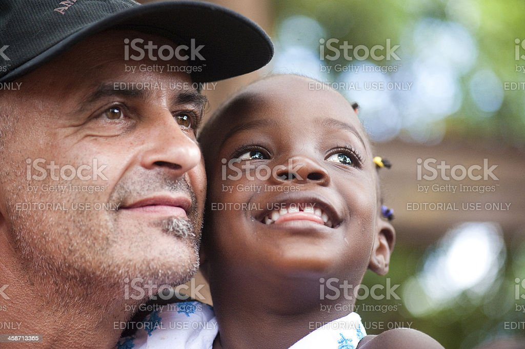 White man and black child looking at the same direction royalty-free stock photo
