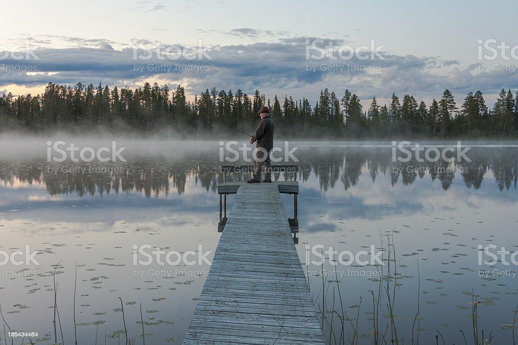 White man fishing stock photo