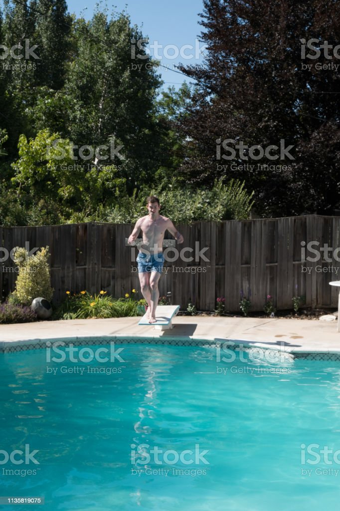 White Man Running To The Edge Of A Diving Board To Jump Into ...