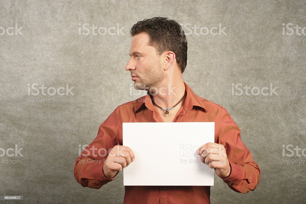 White man with card - space for copy,left profile stock photo