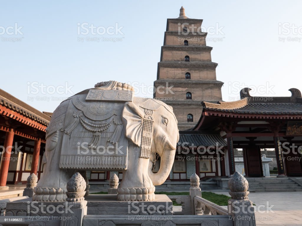 White Marble Elephant with Big Goose Pagoda in the Background, Da Cien Temple, Xi'an, China stock photo