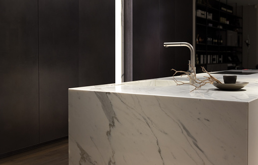 Stylish Solid White Marble Kitchen Counter With Dark Cupboards