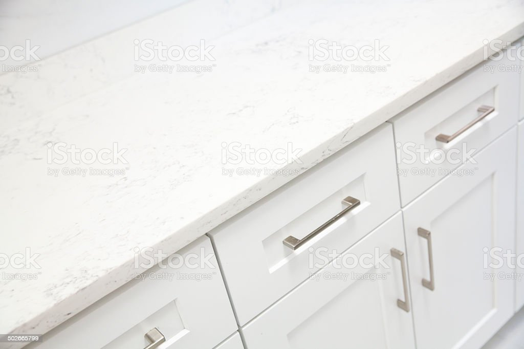 White marble on top of kitchen cabinet stock photo