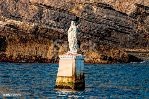 white marble statue of madonna in the sea