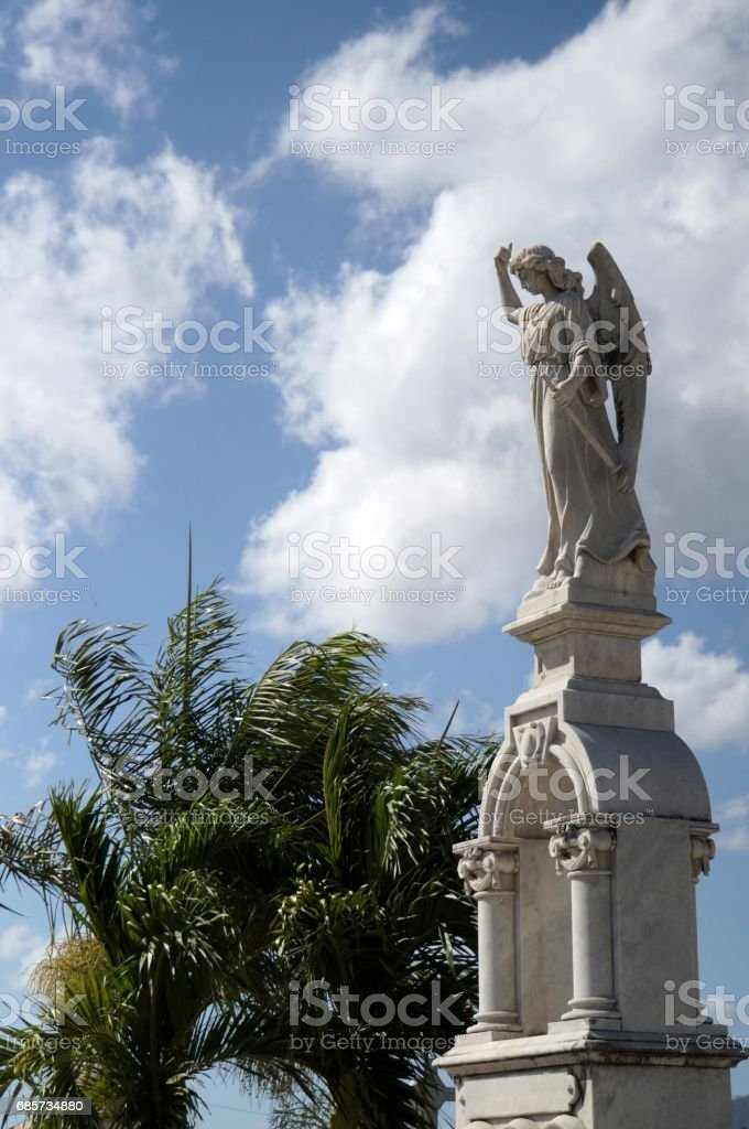 White marble statues at the cemetery royalty-free stock photo