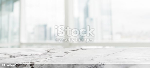 662984906istockphoto White marble stone table top and blur glass window wall building with city view background - can used for display or montage your products. 831024200