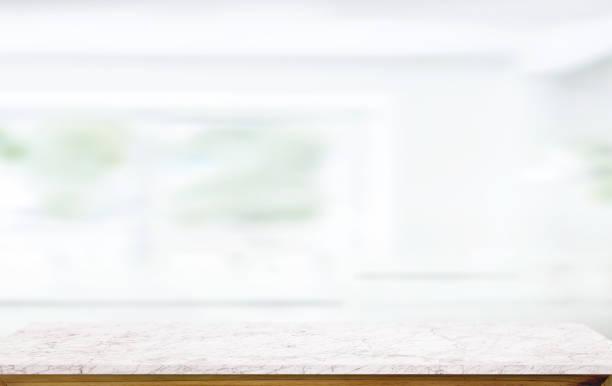 white marble table top on blur kitchen window background. - kitchen counter imagens e fotografias de stock