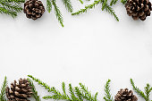 istock White marble table with Christmas decoration including pine branches and pine cones. Merry Christmas and happy new year concept. Top view with copy space, flat lay. 1185167701