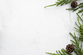 istock White marble table with Christmas decoration including pine branches and pine cones. Merry Christmas and happy new year concept. Top view with copy space, flat lay. 1185167721
