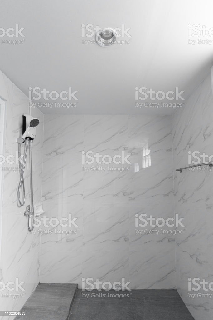 White Marble Tile Wall And Gray Tile Flooring Bathroom In Natural Light Scene Stock Photo Download Image Now Istock