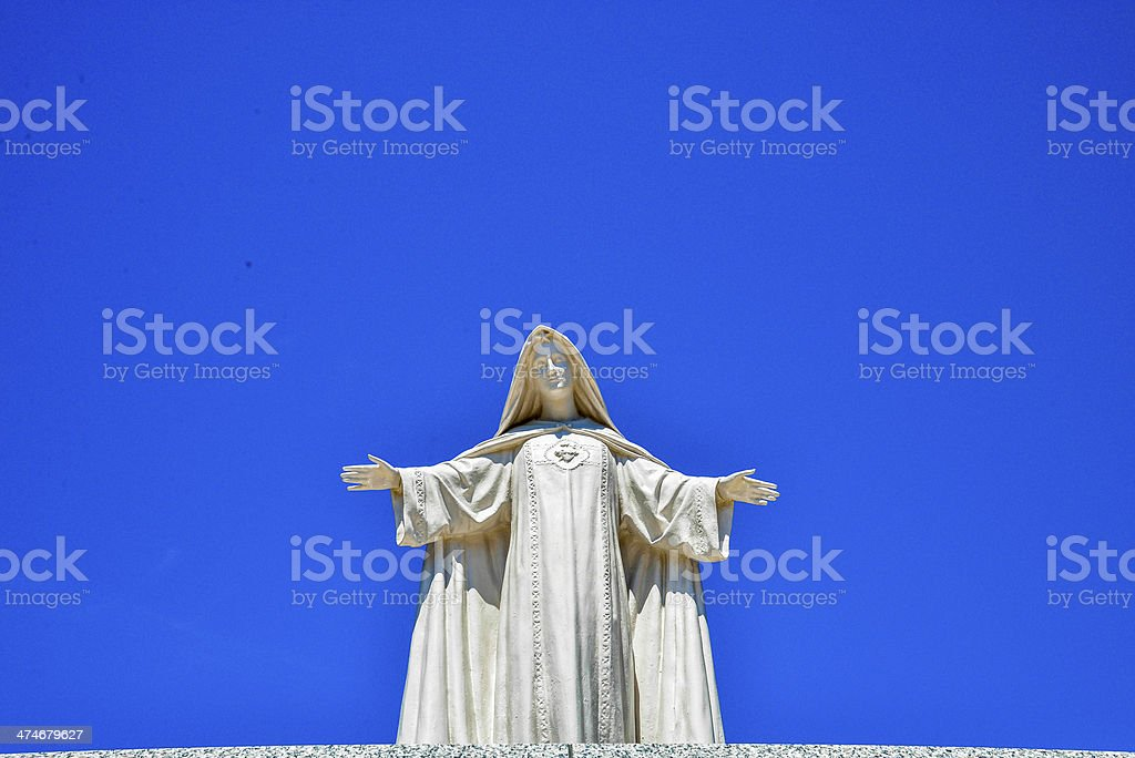 White Maria statue with blue sky1 stock photo