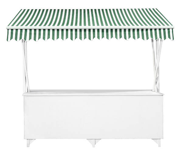 White market stall with green striped awning stock photo