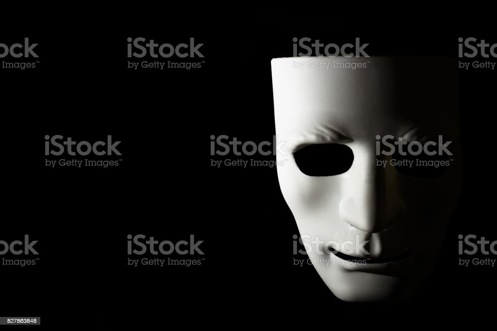 White mask and shadow on black background stock photo