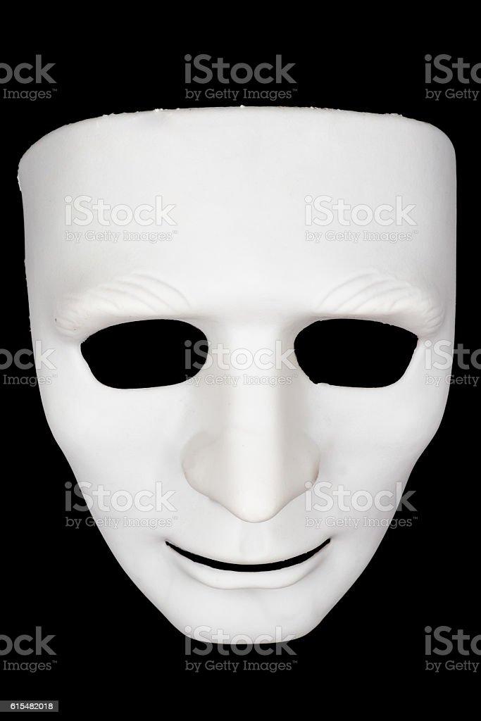 White mask on black background. stock photo