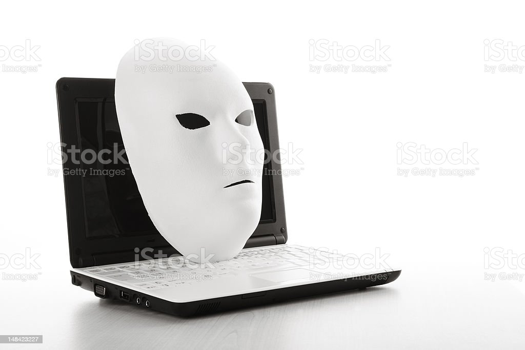 White Mask On Computer For Internet Security Concept royalty-free stock photo