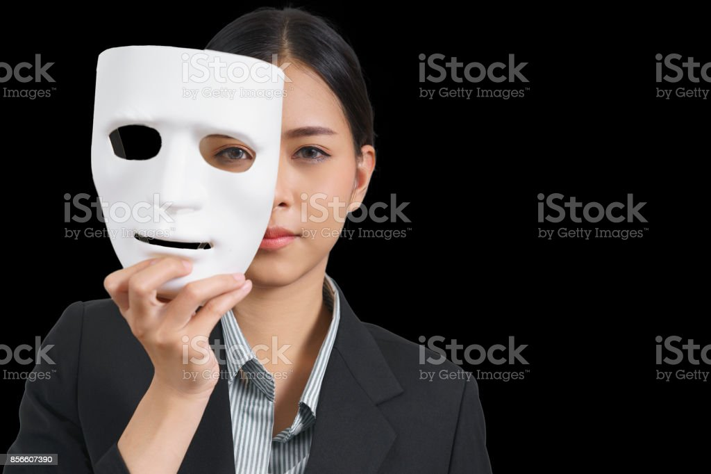 White mask with a businesswoman wearing a suit, concept, spying or ambiguous stock photo