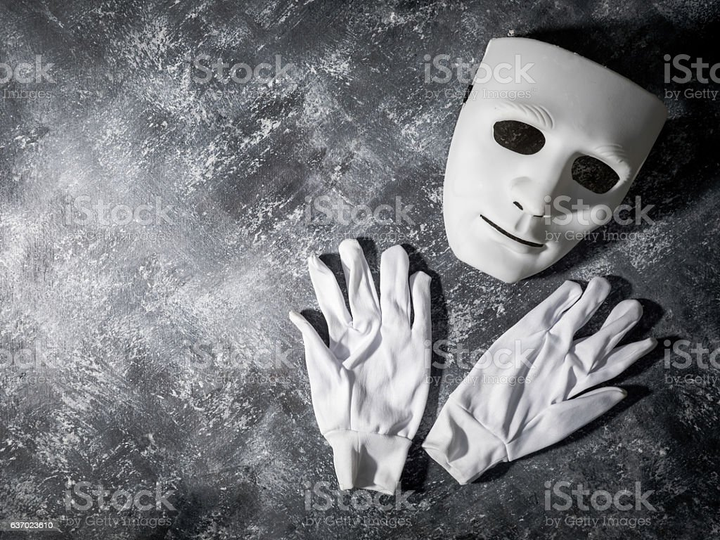 White mask with glove on gray grunge background. stock photo