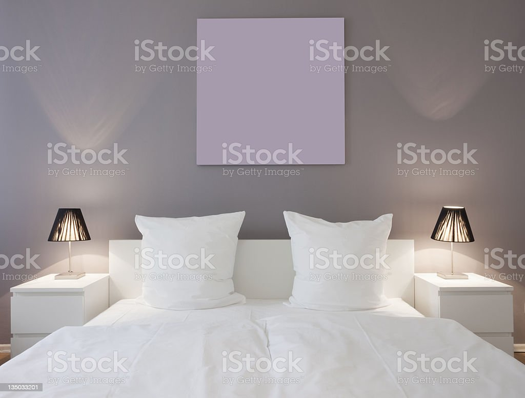 White master bed with white night stands and lights stock photo