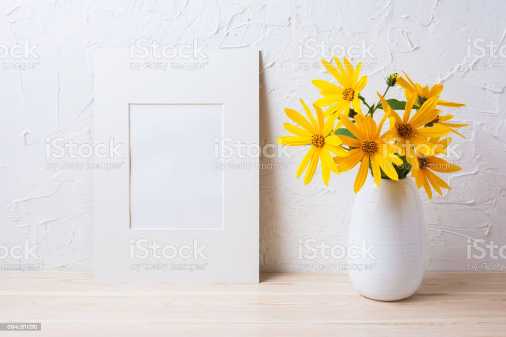 White mat frame mockup with yellow rosinweed flowers in pitcher....