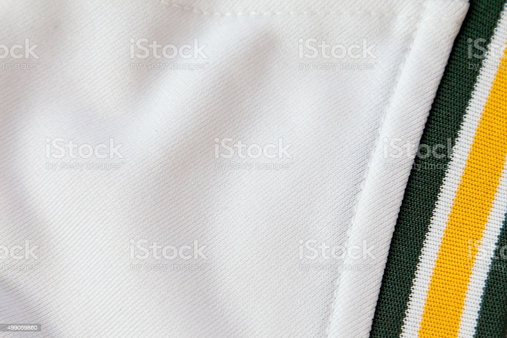 White material with green and yellow band stock photo