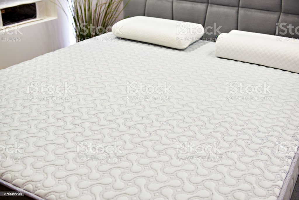 White mattress on double bed stock photo