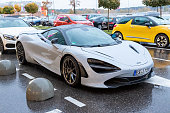 Moscow, Russia - October 9, 2019: White McLaren 720S in the parking lot. Under rain