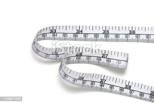 Close up tailor measuring tape on white table background, include clipping path. White measuring tape