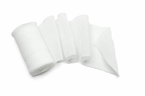 white medical gauze bandage - medical dressing stock pictures, royalty-free photos & images