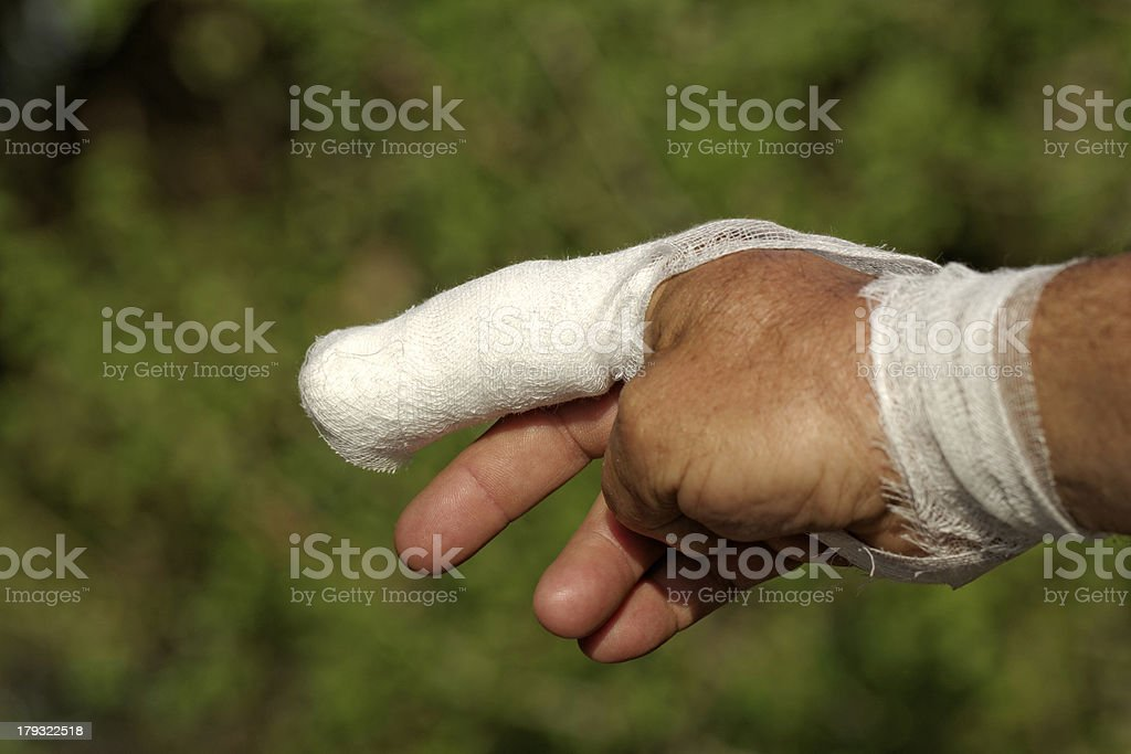 White medicine bandage on human injury hand finger royalty-free stock photo