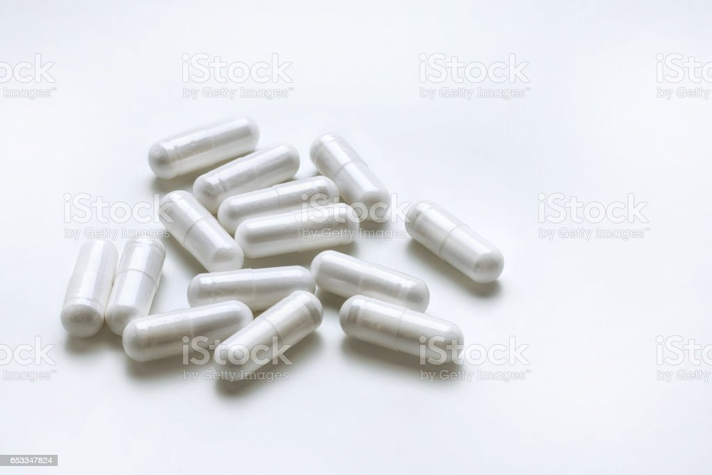 White medicine capsules isolated on white background. stock photo