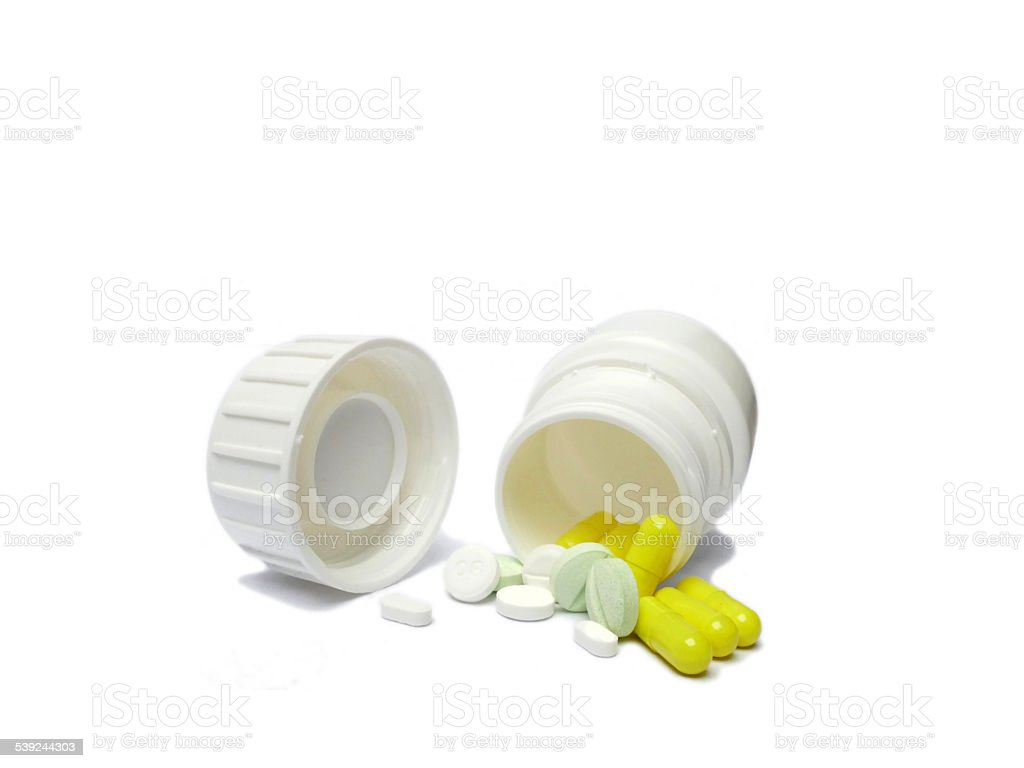 White medicine container with pills spilled and falling out royalty-free stock photo