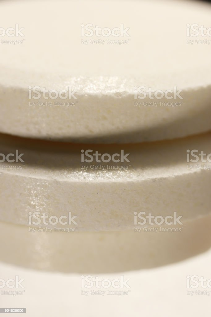 White Medicine Tablets Stack. Pharmacy Pills Background. Macro Closeup. royalty-free stock photo