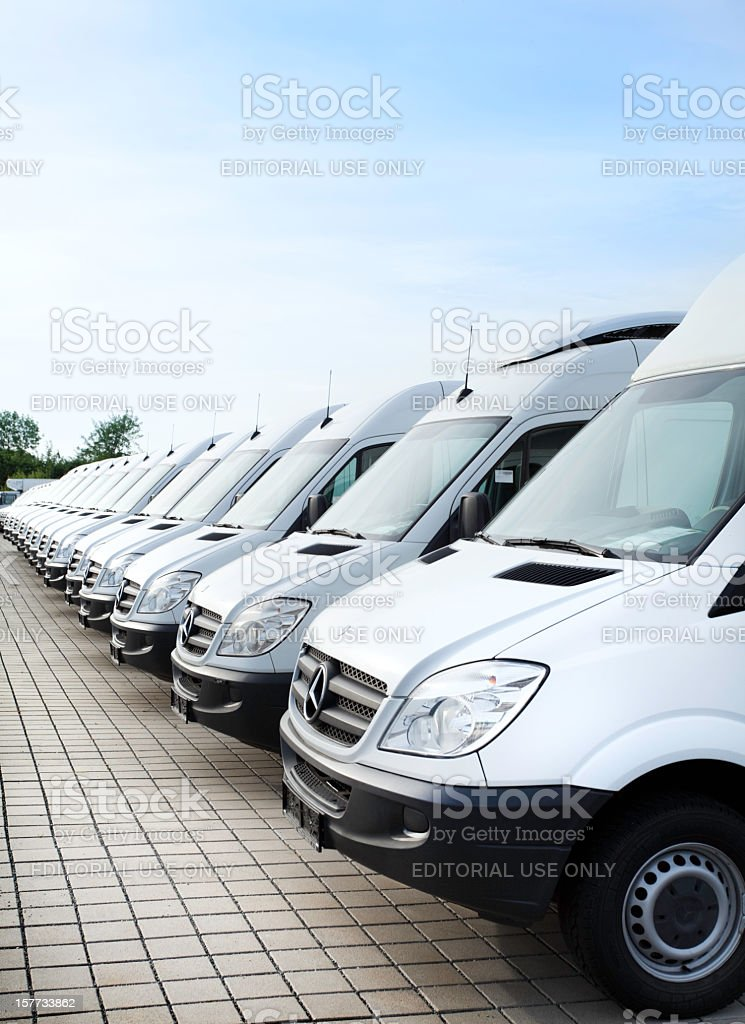 White Mercedes-Benz transporters in a row royalty-free stock photo