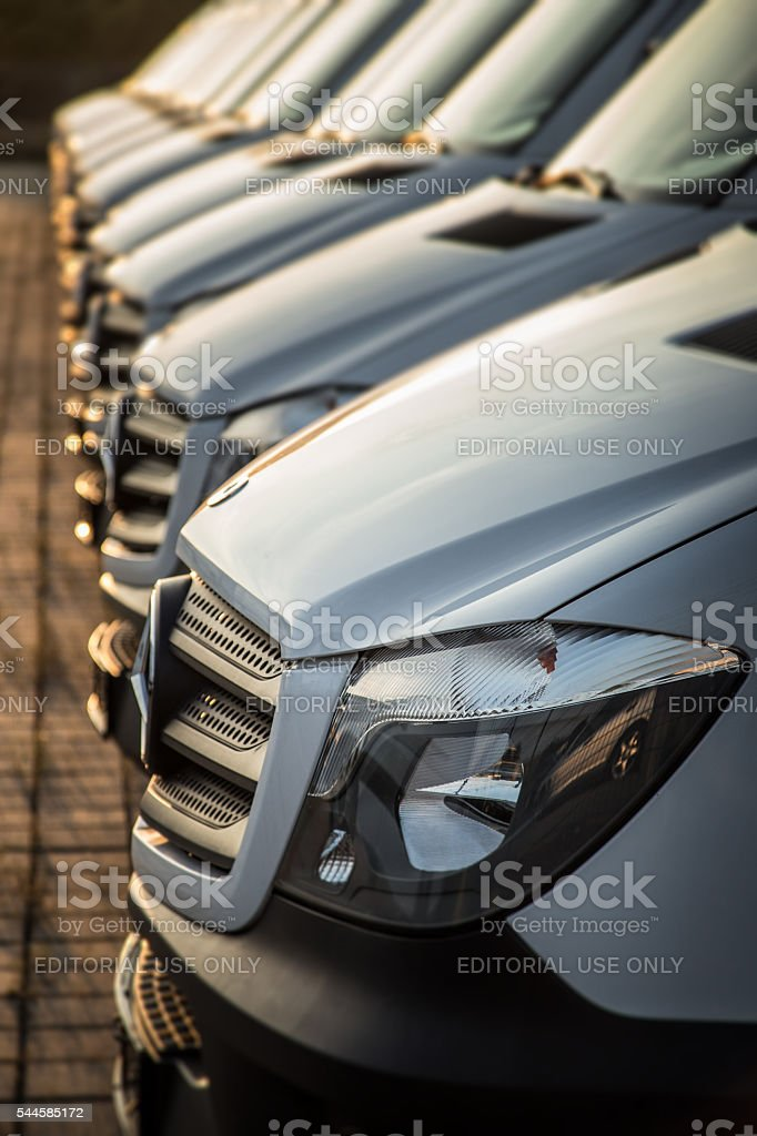 White Mercedes-Benz transporters in a row stock photo